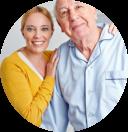 elderly man with her caregiver smiling